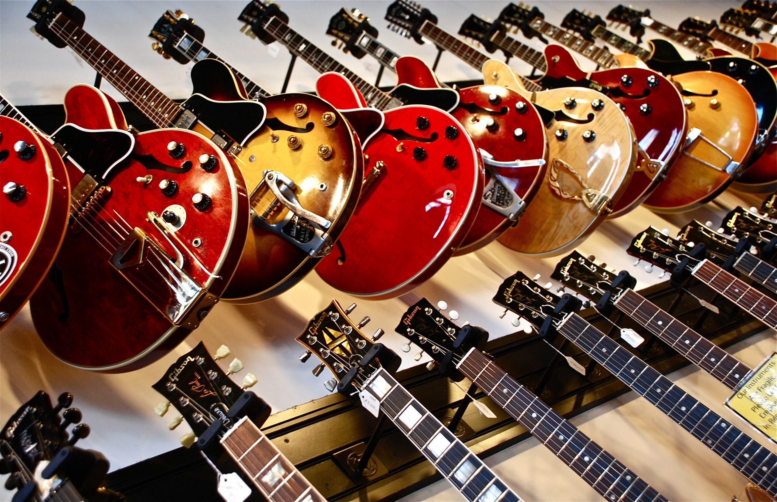 loads of guitars hung up