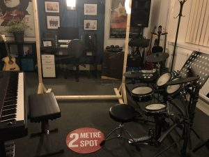 harmony music school drum and piano room 2 meter distance
