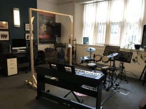 harmony music school drum and piano room with screen