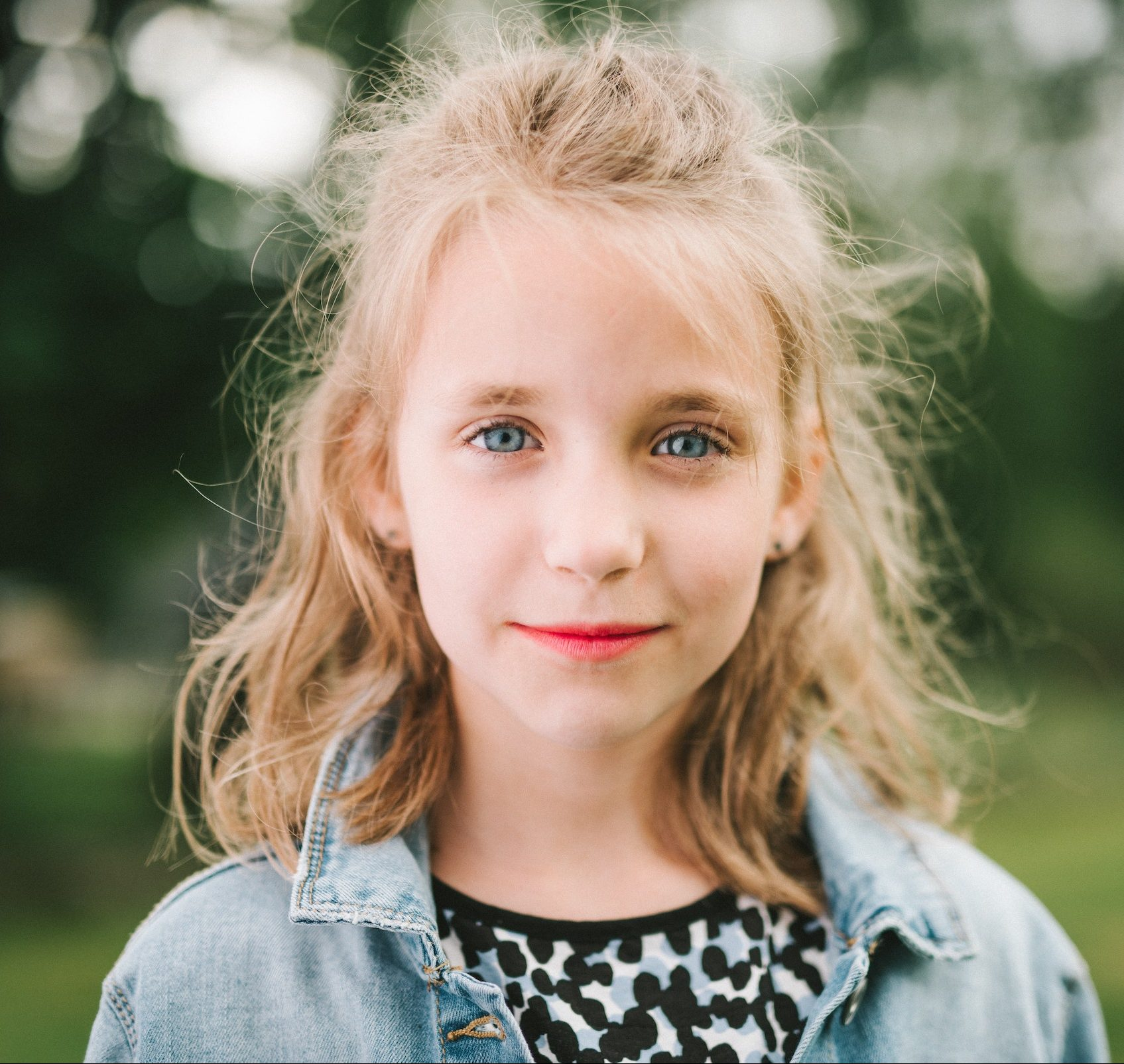 young girl blond hair smiling